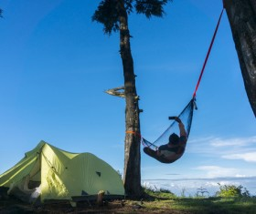 Camping tents and selfie people lying on the hammock Stock Photo