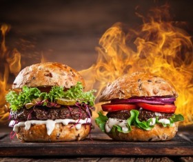 Cheese burger and flame Stock Photo