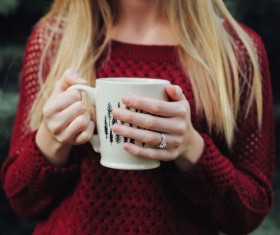 Closeup blonde girl holding cup Stock Photo