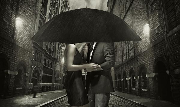 Couple holding an umbrella Stock Photo