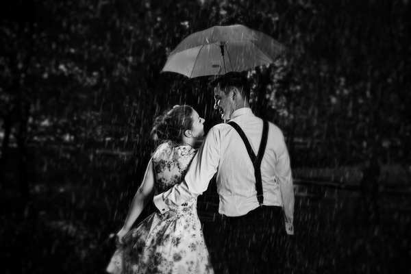 Couple walking with umbrella Stock Photo