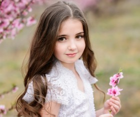 Cute girl holding a flower Stock Photo 02
