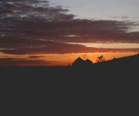 Dark sunset on hill Stock Photo