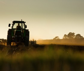 Driving tractor turn up the soil Stock Photo 02