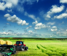 Driving tractor turn up the soil Stock Photo 03