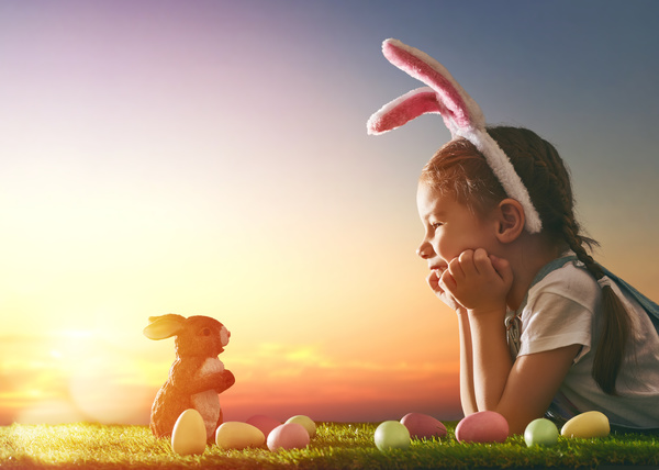 Easter egg and little girl wearing rabbit ears Stock Photo