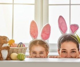Easter eggs and mother and daughter wearing rabbit ears Stock Photo
