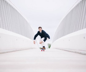 Elegant mens play skateboard Stock Photo