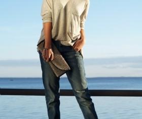 Elegant woman on the pier Stock Photo