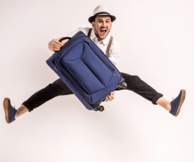 Excited man jumping up Stock Photo