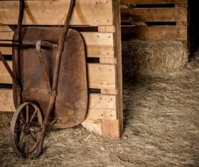 Farmhouse rusty wheelbarrow Stock Photo