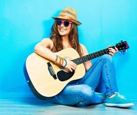 Fashion girl playing guitar Stock Photo