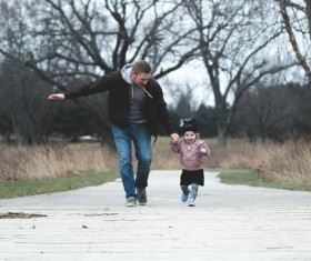 Father accompanied his daughter to run Stock Photo