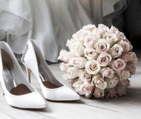Female high heels and bouquet Stock Photo