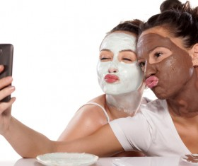 Girl doing facial mask selfie Stock Photo