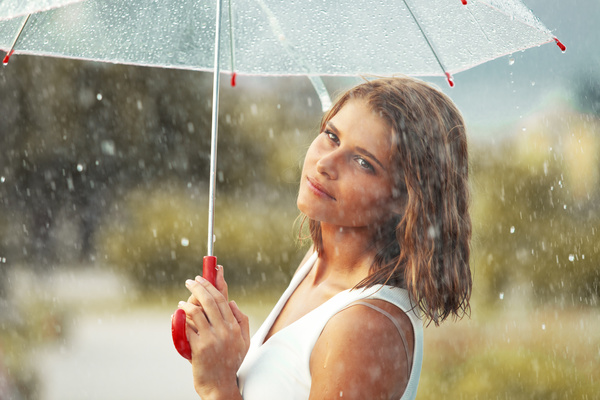 Girl holding an umbrella on rainy day Stock Photo