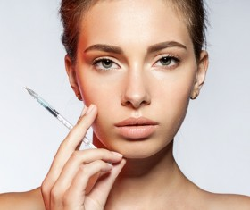 Girl holding botox injection Stock Photo