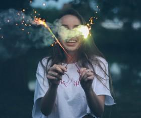 Girl holding fireworks Stock Photo