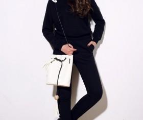 Girl in black costume holding white waist bag Stock Photo
