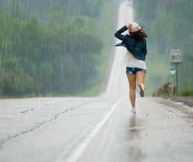 Girl running in the rain Stock Photo