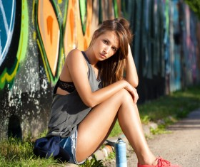 Girl sitting on the roadside resting Stock Photo
