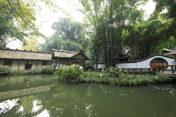 Green bamboo and thatched cottages Stock Photo