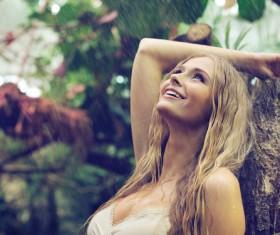Happy girl in the rain Stock Photo