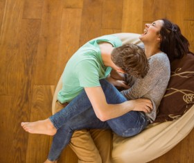 Happy lovers on inflatable chair Stock Photo