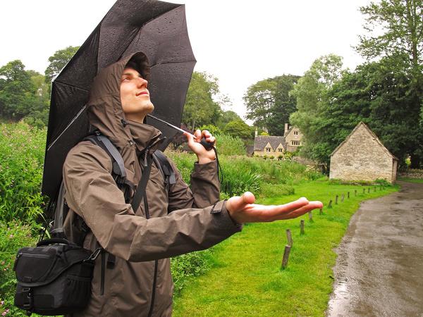 Happy man on rainy day Stock Photo