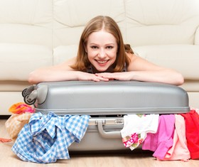 Happy woman ready to travel Stock Photo