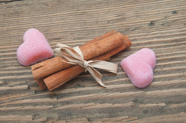 Heart shaped candy and cinnamon Stock Photo