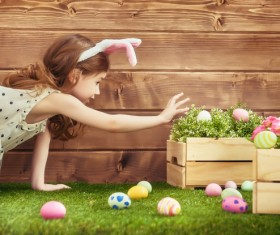Little girl holding Easter egg Stock Photo