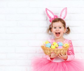 Little girl holding a basket with Easter eggs Stock Photo