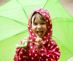Little girl holding an umbrella on a rainy day Stock Photo
