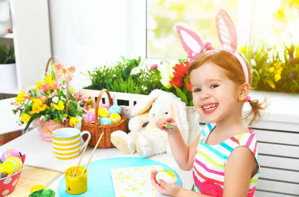 Little girl with painted Easter eggs Stock Photo
