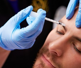 Male forehead botulinum injection Stock Photo