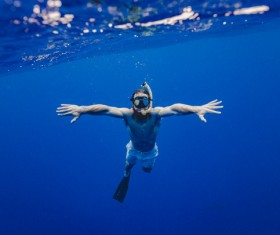 Man diving in sea with snorkel Stock Photo