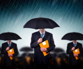 Man holding an umbrella holding folder Stock Photo
