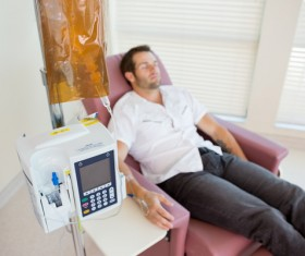 Man lying in sofa on infusion Stock Photo