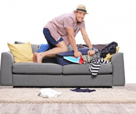 Man preparing clothes for travel Stock Photo