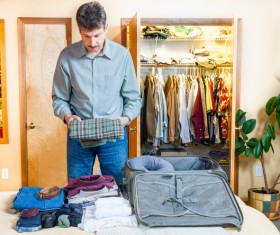 Man preparing for a business trip Stock Photo