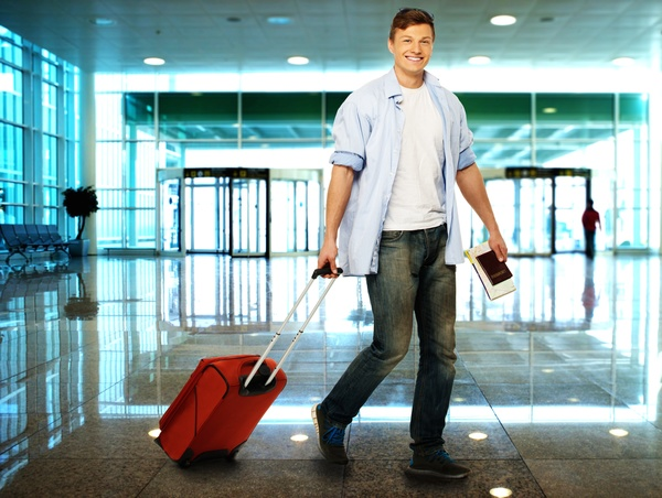 Man pulling a suitcase to travel Stock Photo