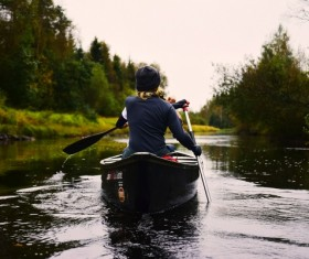 Man rowing on calm river Stock Photo