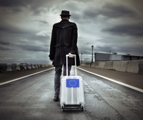 Man traveling with suitcase Stock Photo