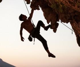 Men free solo rock climbing Stock Photo 01