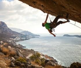 Men free solo rock climbing Stock Photo 02