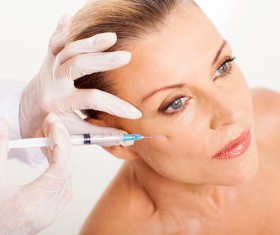 Middle-aged female facial botox injection Stock Photo 01