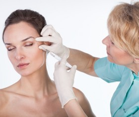 Middle-aged female facial botox injection Stock Photo 02
