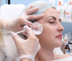 Middle-aged female facial botox injection Stock Photo 03