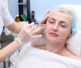 Middle-aged female facial botox injection Stock Photo 04